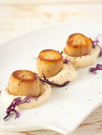 Seared vegan scallops with truffle celery root purée